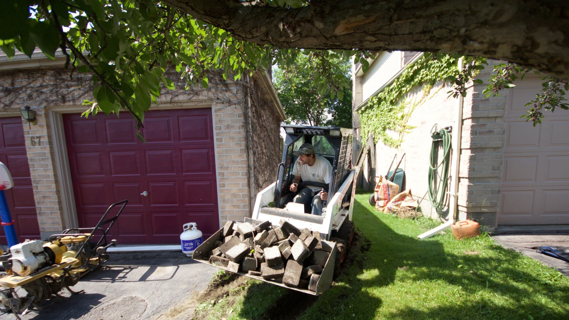 Removing old paving stones in preparation for a new backyard patio. A landscaping project in London Ontario.