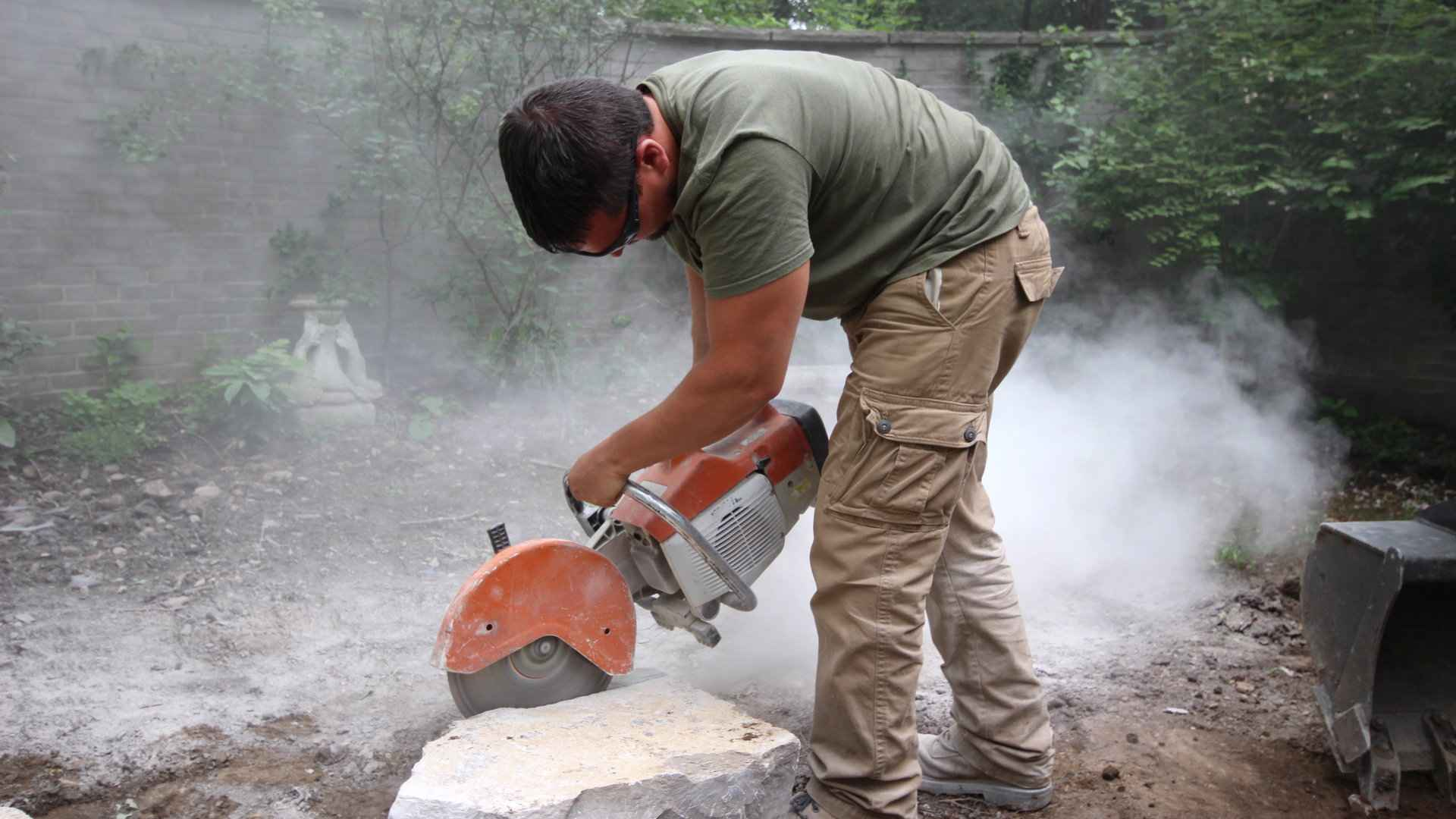 A landscaping project in London Ontario. Nate cutting stone.