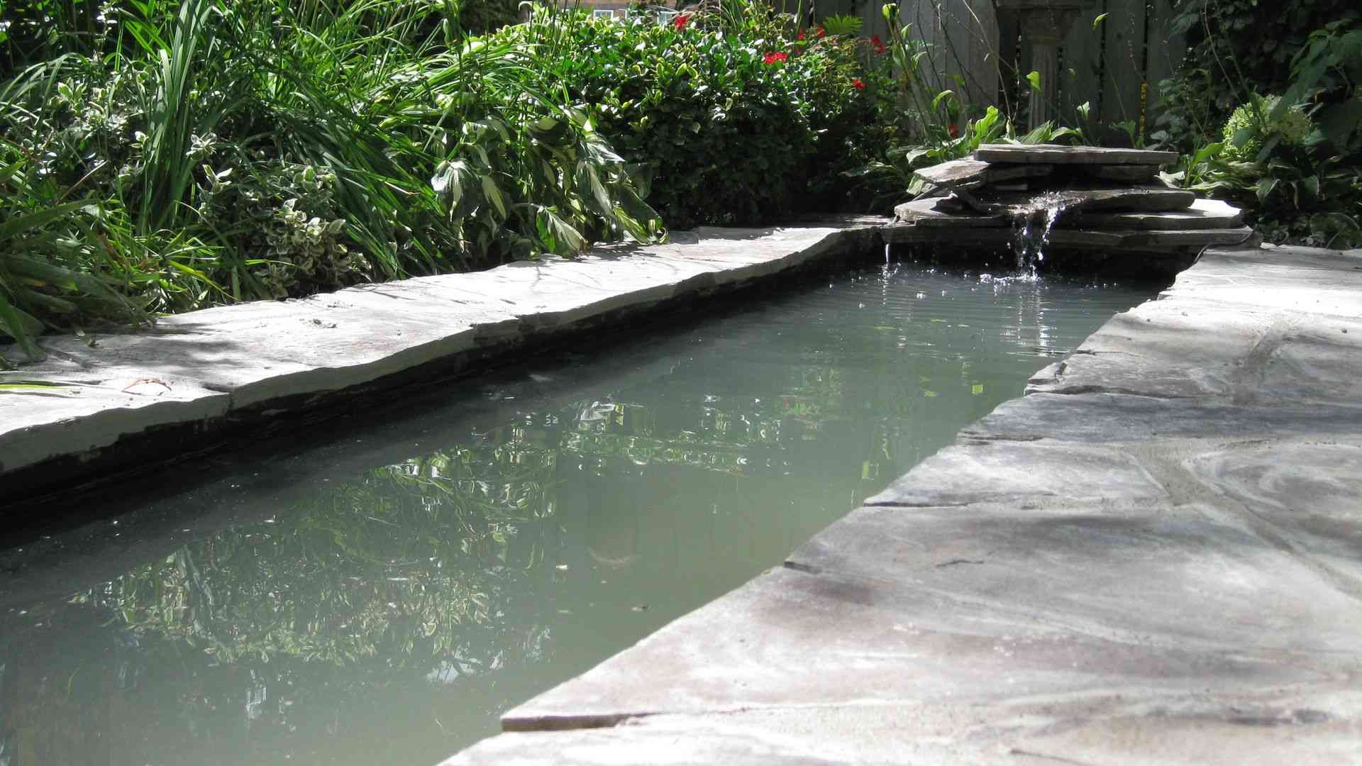 Modern landscaping project, hardscaping and stonework, a pond, London Ontario.
